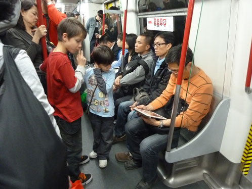 Tai & Spike on the MTR in Hong Kong